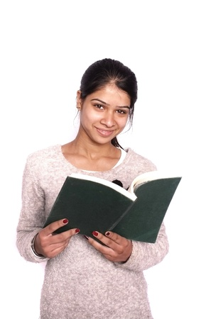 indian girl: Cute Indian  Asian college student reading book over isolated white background