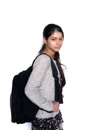 winters: Back to school  Cute Indian student smiling with backpack, over isolated white background