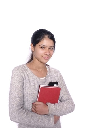 Pretty Indian  Asian college student over isolated white background  photo