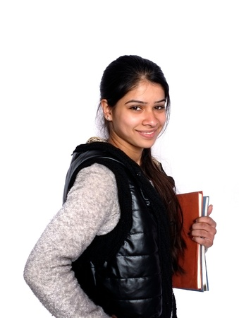 Portrait of casual Indian college student holding books over isolated white  photo