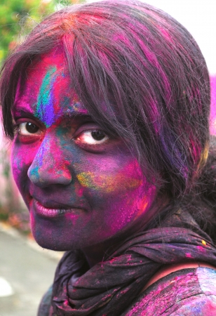 Closeup of an Indian female woman painted black on Holi festival in India.