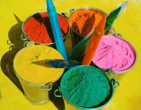 Bucket full of powdered colors  gulal and pichkaari on Holi in India. photo
