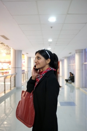 Indian Woman talking on phone in a mall. photo