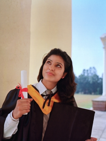 thanking: Pretty Indian College graduate thanking God after getting degree. Stock Photo