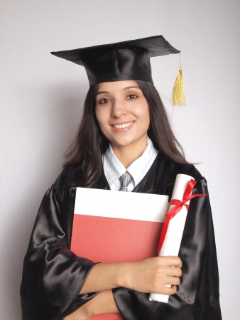indian girl: Young college graduate holding degree after convocation ceremony.