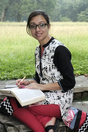 Beautiful indian college student studying photo
