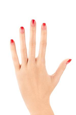 ombre: Female hand with red to pink ombre nail polish on white background Stock Photo