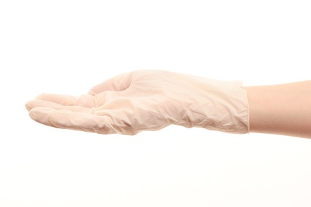 surgical glove: Close up of female doctors hand in white sterilized surgical glove against white background Stock Photo