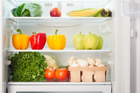 obesity: Open refrigerator full of fruits and vegetables. Weight loss diet concept.