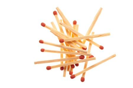 household accident: Pile of red wooden matches isolated on white background