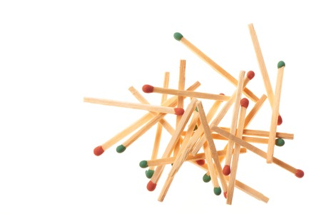 household accident: Pile of red and green wooden matches isolated on white background Stock Photo
