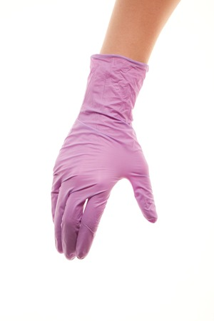 surgical glove: Close up of female doctors hand in purple sterilized surgical glove giving for handshake against white background