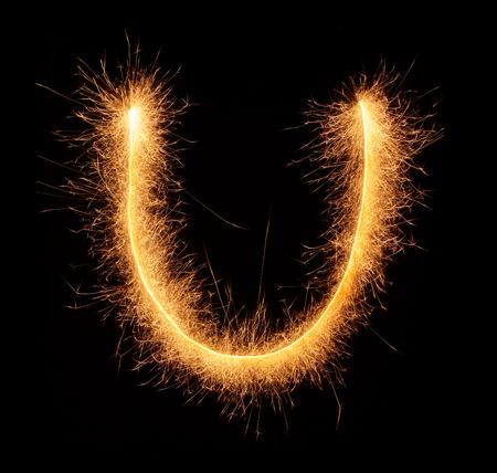 bengali: U letter drawn with bengali sparkles isolated on black background