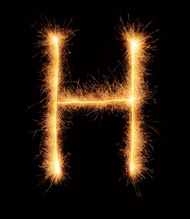 bengali: H letter drawn with bengali sparkles isolated on black background