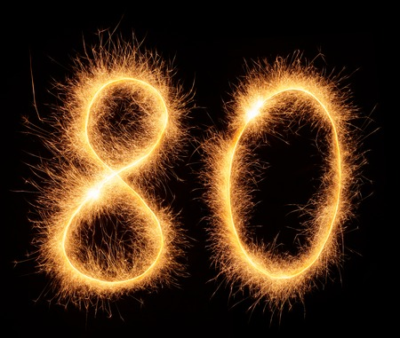 bengali: 80 number drawn with bengali sparkles isolated on black background Stock Photo