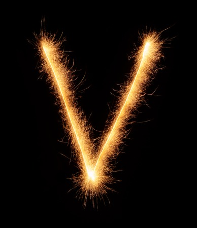 fire letter: V letter drawn with bengali sparkles isolated on black background Stock Photo