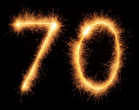 bengali: 70 number drawn with bengali sparkles isolated on black background Stock Photo