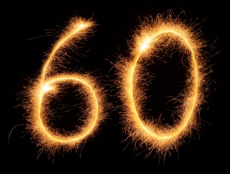 60 number drawn with bengali sparkles isolated on black background Фото со стока