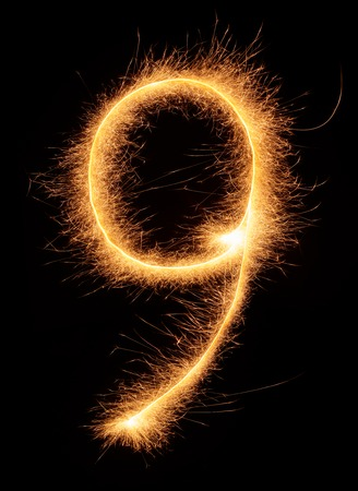 bengali: 9 number drawn with bengali sparkles isolated on black background Stock Photo