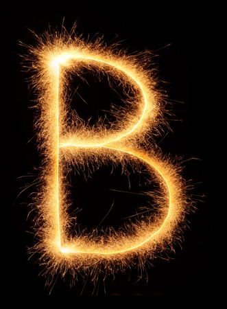 bengali: B letter drawn with bengali sparkles isolated on black background Stock Photo
