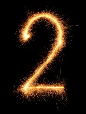 2 number drawn with bengali sparkles isolated on black background