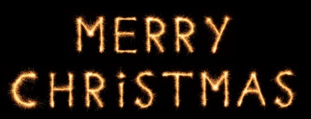 bengali: MERRY CHRISTMAS lettering drawn with bengali sparkles isolated on black background Stock Photo