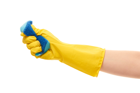 up service: Close up of female hand in yellow protective rubber glove squeezing blue cleaning sponge against white background