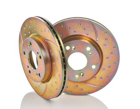 travel industry: Two new car brake disks isolated on white background. Clipping path included. Stock Photo