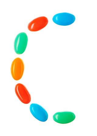 letter c: C letter made of multicolored candies isolated on white background Stock Photo