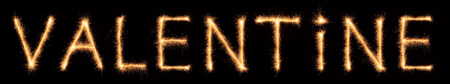 abstract fire: valentine lettering drawn with bengali sparkles isolated on black background