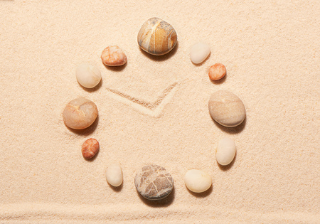 sand watch: Watch from sea stones on sand. Summer beach background. View from above Stock Photo
