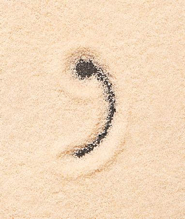 comma: Comma symbol written on sand. Summer beach background Stock Photo