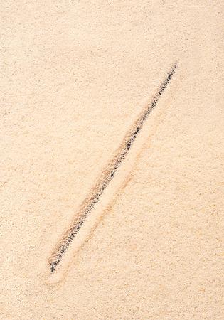 slash: Forward slash symbol written on sand. Summer beach background