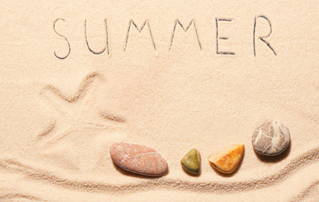 sea mark: Mark of starfish, sea stones and summer lettering drawn on sand. Summer beach background. View from above Stock Photo
