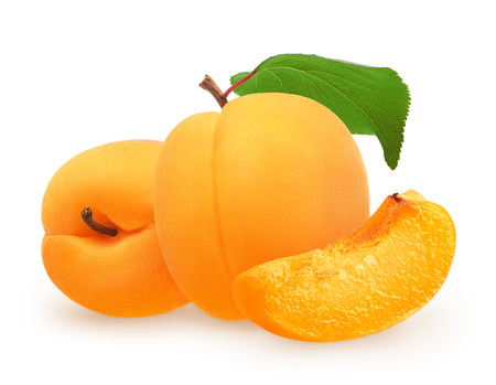 Whole fresh apricot fruit with green leaf next to apricot lying on its side and slice isolated on white background