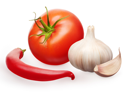 Whole fresh red tomato with green leaf, garlic with clove and chili pepper vegetables isolated on white background