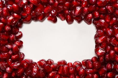 Rectangle of fresh pomegranate seeds isolated on white background