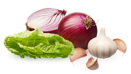 Whole fresh unpeeled red onion with half, garlic with cloves and green salad isolated on white background