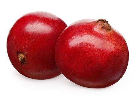 Whole fresh pomegranate fruit next to lying on its side isolated on white background