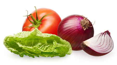 Whole fresh red tomato with green leaf, unpeeled red onion with slice and green salad isolated on white background