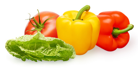 Whole fresh red tomato with green leaf, yellow and red bell peppers and green salad isolated on white background Фото со стока