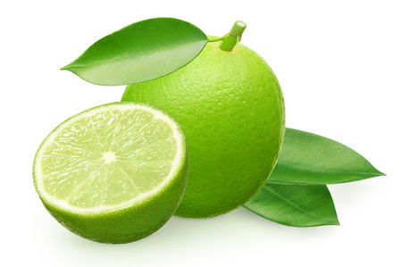 Whole fresh lime fruit with half and green leaves isolated on white background Фото со стока