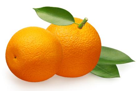 Whole fresh orange fruit next to orange lying on its side and green leaves isolated on white background