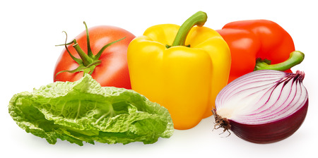 Whole fresh red tomato with green leaf, yellow and red bell peppers, half of unpeeled red onion and green salad isolated on white background Фото со стока