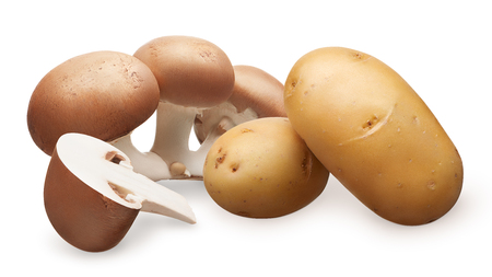 Group and half of fresh royal champignon mushrooms and two whole fresh unpeeled potatoes isolated on white background 스톡 콘텐츠
