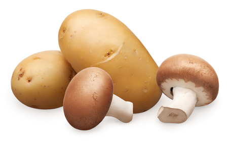 Two fresh royal champignon mushrooms and two whole fresh unpeeled potatoes isolated on white background Stock Photo