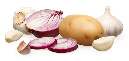 Whole fresh unpeeled potato, half of red onion with two chopped pieces and garlic with cloves isolated on white background Stock Photo