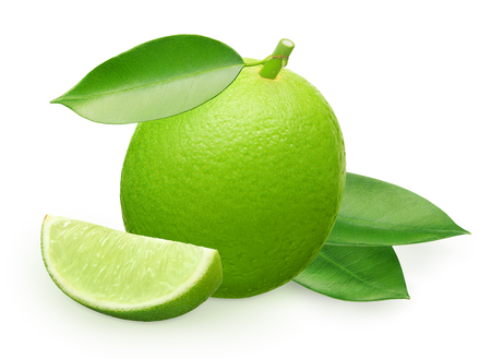 Whole fresh lime fruit with slice and green leaves isolated on white background