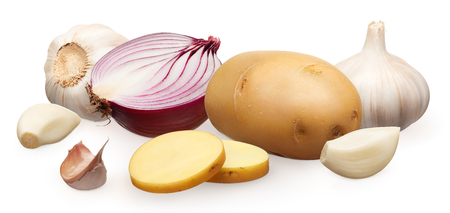 Whole fresh unpeeled potato with two chopped pieces, half of red onion and garlic with cloves isolated on white background