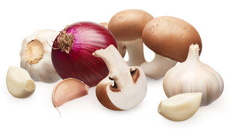 Whole fresh royal champignon mushrooms with half, unpeeled red onion and garlic with cloves isolated on white background